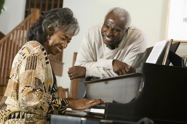 older Couple playing piano